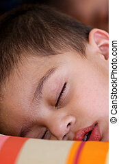 Kid sleeping - Cute Indian kid in deep sleep on a colorful...