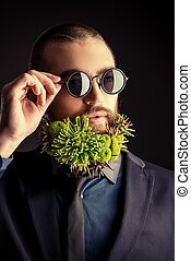 stylist - Handsome man in sunglasses and with a beard of...