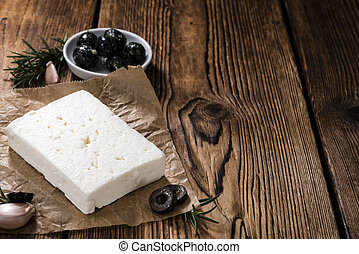 Feta Cheese on wooden background as detailed close-up shot