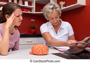 female doctor and patient talking about headaches or...