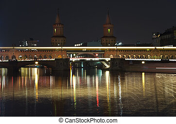 berlin oberbaumbr?cke bridge at night with a passing metro...