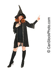 Evil witch - Young woman with red hair as evil witch...