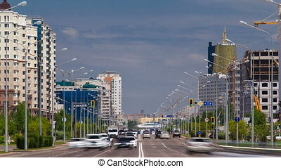 Traffic drives over the wide boulevards of Astana in...