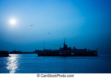 ship silhouette against the blue sky