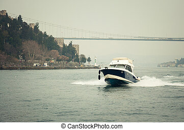 Bosphorus - small boat sailing on the Bosphorus