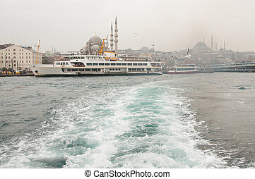 Bosphorus - white ship sails along the Bosphorus in Istanbul...