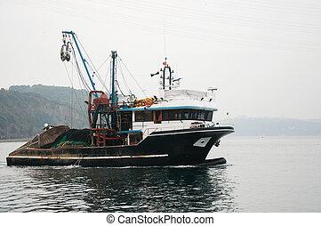 boat - black fishing boat on the Bosporus