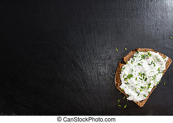 Slice of Bread with fresh made Herb Curd (detailed close-up...