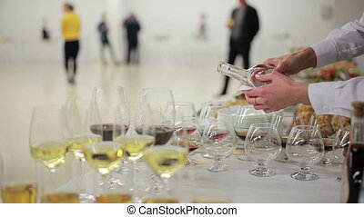 waiter pouring brandy into glasses at a reception - waiter...