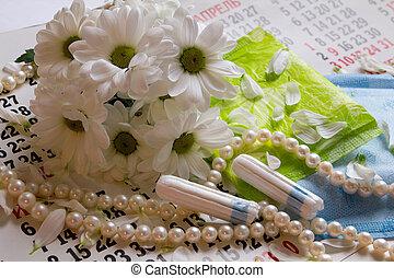 Woman critical days, menstrual period, pad, napkin, cotton...