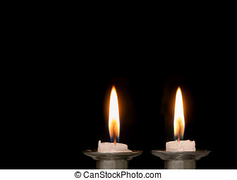 Jewish Sabbath candles burning low - Two lighted Shabbat...