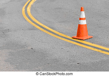 Orange traffic cone on double yellow lines - Stained gray...