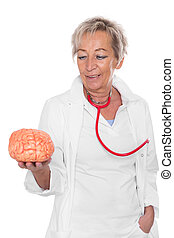 female doctor is holding an brain - female doctor is holding...