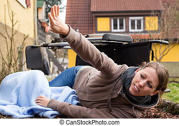 young woman had an accident - young woman lies on the...