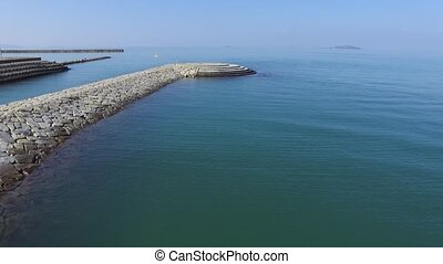 aerial drone flying breakwater - Aerial view of breakwater...
