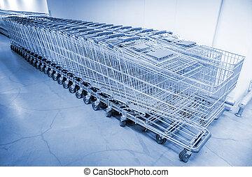 shopping carts - abstract shopping carts at parking lot