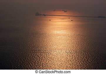 Hazy golden sunset on Elephanta island (Mumbai harbour)