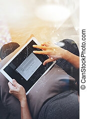 top view of hipster hands using digital tablet pro with...