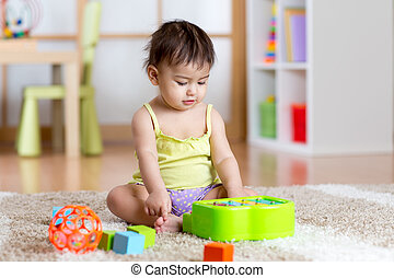 Child with develepmental toys. Early education for kids....