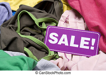 Clothing at a Flea - Stir clothing at a flea market or...