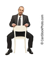 man sit on chair - confident businessman sit on white chair...