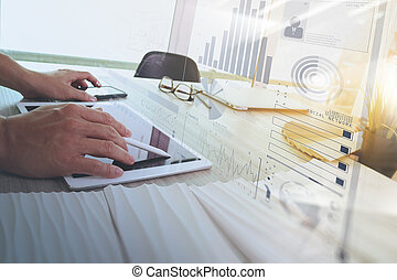 interior designer hand working with digital tablet computer and sample material on wooden desk as concept