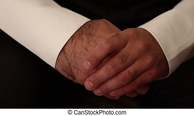 hands of the man in jacket