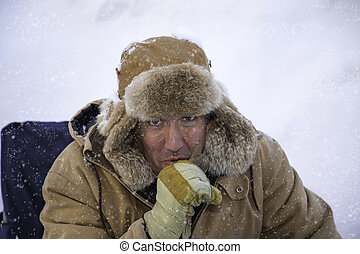Man bundled up in sub zero winter weather - A man in the...