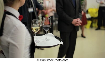 waiter holding a tray with glasses of wine - waiter holding...