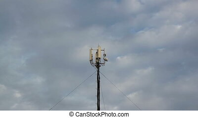Cellular tower against the sky - Cellular tower with...
