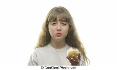 Young girl eating a pear