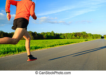 Man running on country road, training inspiration and...