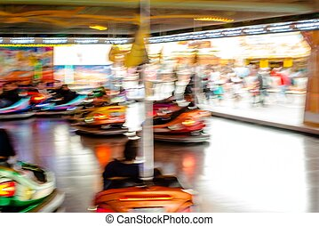 Bumper cars, people driving at the funfair Motion blur