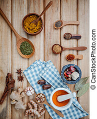 Food Cooking ingredients. Dried Spices herb cinnamon sticks,bay leaves,ginger,turmeric,nutmeg,chili,black pepper,fennel and saffron with the mortar on rustic wooden background.