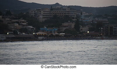 Beach with hotels at evening Fast motion