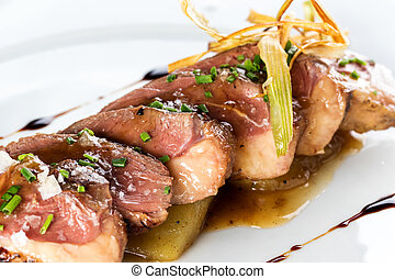 Grilled duck breast with sweet apple sauce.