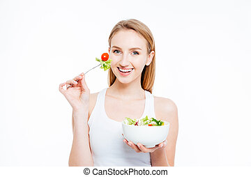 Woman eating healthy food - Charming young woman eating...