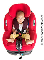 Baby boy sitting in car seat isolated