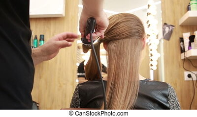 barber makes the cut for adult woman. doing curls