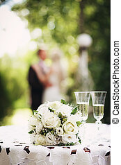 Wedding bridal bouquet with white roses on the table in the...