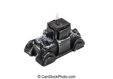 Souvenir gift candle in the shape of black retro car isolated on white background.