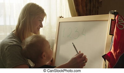 Boy Drawing Scribbles on the Marker Board - Little boy is...