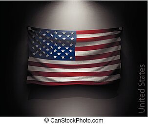 waving flag United States on a dark wall with a spotlight,...