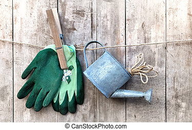 watering can and gloves