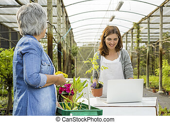 Worker and customer in a flower shop