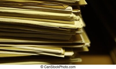 Old papers in archive - Stacks of old papers in archive...