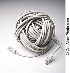 Ball of network cables - Rolled computer cables on grey...
