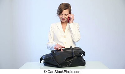 girl searching for a phone in his bag girl in white business...