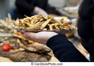 Roasted fish street food - Fried little fish snack on a dish...