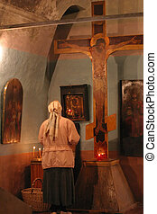 Pray god at crucifix in a church religion scene